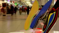 Orthopedic shoe insoles , on the background of the shopping mall. crowd people make purchases . video