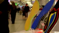 Orthopedic shoe insoles , on the background of the shopping mall. Crowd people make purchases video