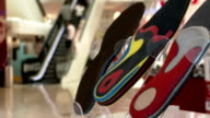 Orthopedic shoe insoles , on the background of the shopping mall. video