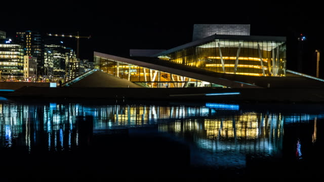 Oslo Opera House and cityscape with Reflection at night Timelapse video