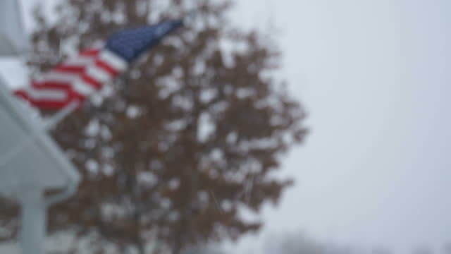 Out of Focus American Flag in Snow Storm video