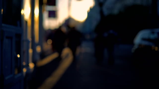 Out of focus background and unrecognizable people walking around the city video