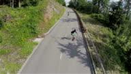 Over head aerial footage of longboard skaters video