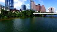 Over Lady Bird Lake Austin Texas Skyline Cityscape Side Pan kayakers video