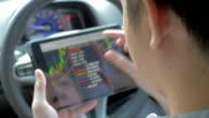Over shoulder shot of businessman using digital tablet in car video