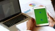 Over shoulder shot of Businessman using digital tablet,Green screen, 4K(UHD) video