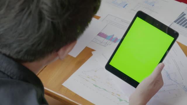 Over shoulder shot of Businessman using digital tablet,Green screen video