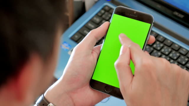 Over shoulder shot of Using smart phone,Green screen video