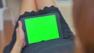 Over shoulder shot of women using digital tablet,Green screen video