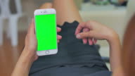 Over shoulder shot of women using smart phone,Green screen video
