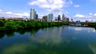 Over Town Lake with Mirror Image of Clouds reflecting in the Colorado River backing up away from City video