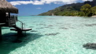Over water bungalow with steps into amazing lagoon video