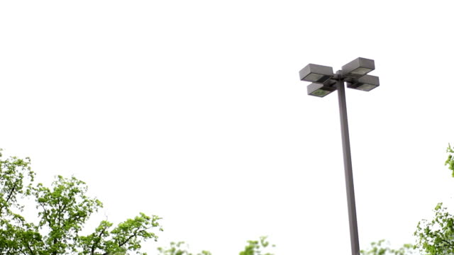 Overcast establishing shot of parking lot night light with trees in background video