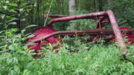Overgrown Farm Equipment Sits Abandoned in the Forest video