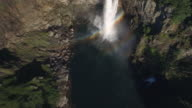 Overhead Aerial View of Epic Waterfall with Double Rainbow in Water Spray video