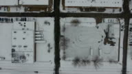 Overhead Aerial View of Snow Covered Street and building video