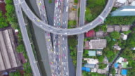 Overhead aerial view of traffic on stack express highway video