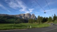 Overhead cable car with Dolomites mountain range video