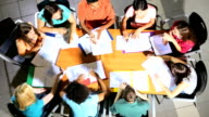 Overhead Female Lecturer Working Classroom Teenage Students video