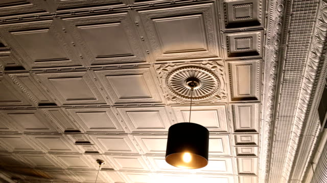 Overhead golden light in victorian restarant against beautiful ceiling video