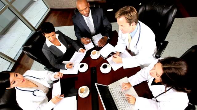 Overhead Look at Medical Executive Boardroom Meeting video