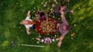 Overhead shot of family throwing fall leaves video