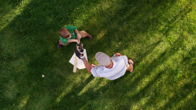 Overhead shot of father and son playing baseball video