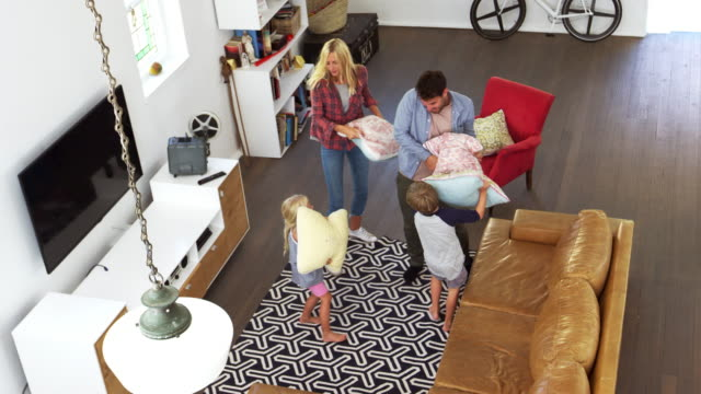 Overhead Shot Of Parents Having Cushion Fight With Children video