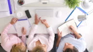 Overhead View Of Businesspeople Working At Office Computer video