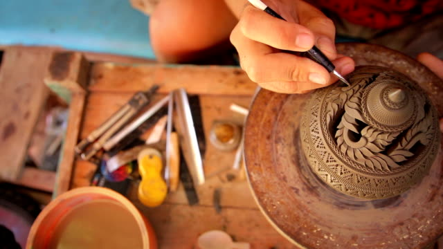 Overhead view of Carved pottery,Dollyshot video