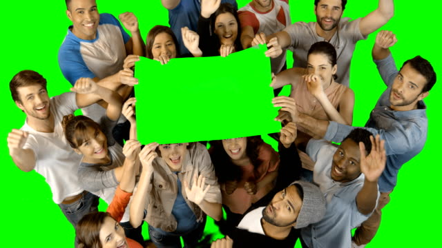 Overhead view of excited executives holding blank green placard video