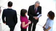 Overhead View Of Hospital Staff Meeting In Busy Reception video