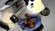 Overhead view of man working at desk video