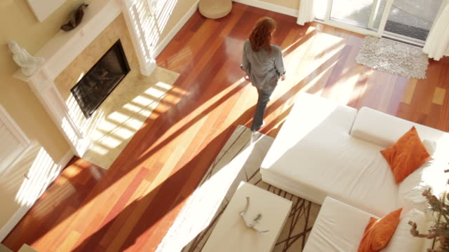 Overhead view of woman walking through modern home video