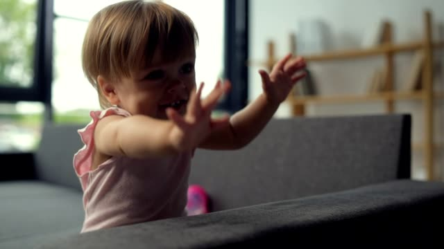 Overjoyed toddler sitting on the couch video