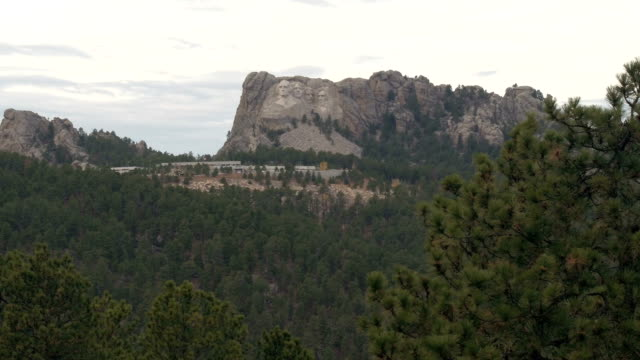 Overlooking famous Mt Rushmore National Memorial sculpture carved into granite video