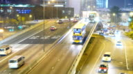 Overpass, road junction, real-time traffic in the night video