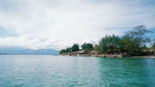 Overview of the ocean, islands and beautiful views of the island of Bali. Bali is the ancient temples, the ever blue ocean and sky, bright green coconut palms, sun and white sand beaches video