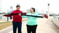 Overweight couple exercising with resistance bands video