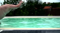 Overweight man jump in to the pool. video