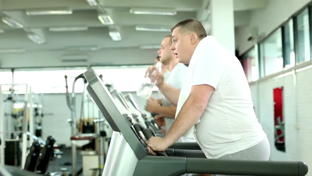Overweight man on trademill. video