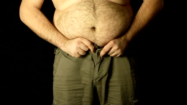 overweight man trying to get into jeans video