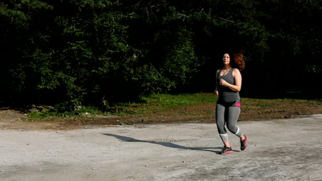 Overweight woman running. Weight loss concept. video