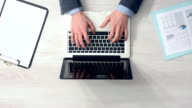 Overworked businessman at office desk video