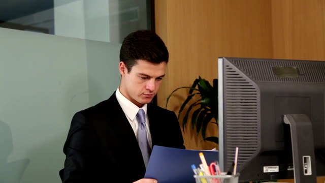 Overworked businessman sighs after seeing what work he has left video