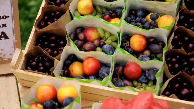 Packages with fresh fruit in box on wedding day in forest video