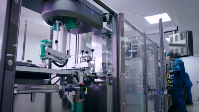 Packaging line at pharmaceutical plant. Chemical manufacturing plant video