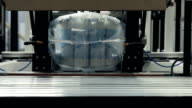 Packaging machine packing paper rolls in plasstic wrapping video