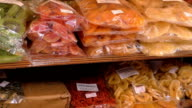 Packed dried fruits at the market video