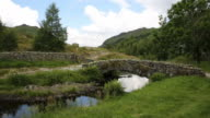Packhorse bridge Watendlath Tarn Lake District Cumbria England uk video